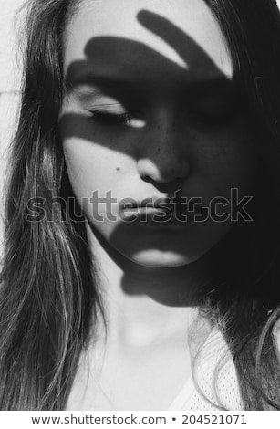 beautiful woman with downcast eyes stock photo © andreypopov