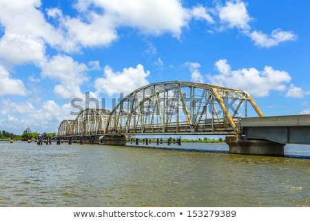 Stock photo:  old bridge in East area of New Orleans crossing the bay