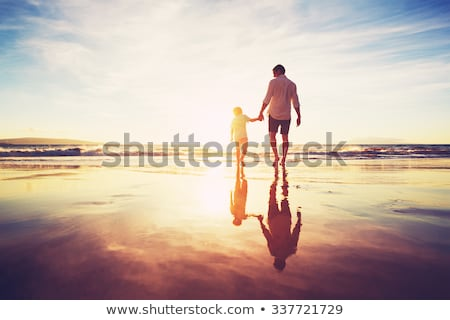 Stock photo: Happy father with son on beach