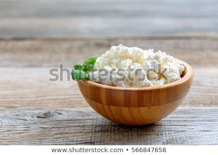 Túró étel fa asztal tányér kövér Stock fotó © yelenayemchuk