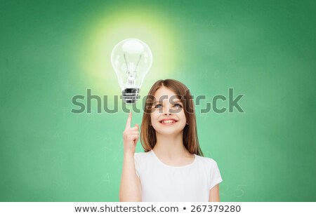 idea and light bulb sign over green blackboard Stock photo © marinini