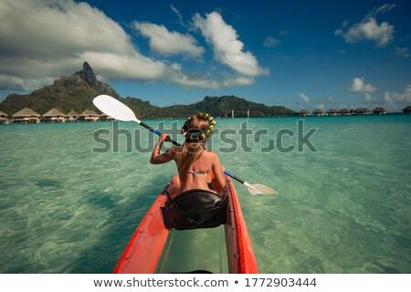 woman kayaking on beautiful mountain lake stock photo © feverpitch