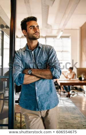 handsome business man looking away and thinking stock photo © feedough