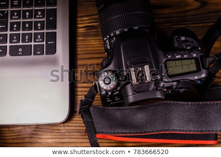 Stock photo: Closeup Of DSLR Photo Camera And Still Lens On Desk