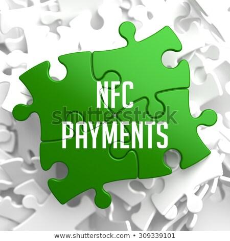 NFC on Green Puzzle. Stock photo © tashatuvango