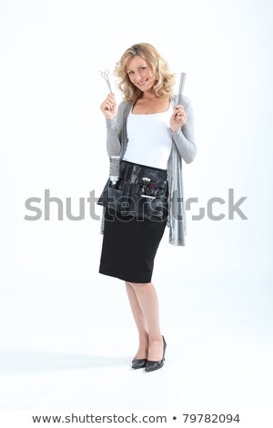 full length portrait of a smiling woman combing her hair stock photo © deandrobot