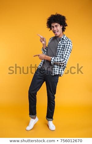 портрет · случайный · молодым · человеком · указывая · пальца · далеко - Сток-фото © deandrobot