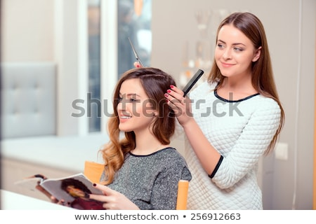 Stock photo: Pretty woman with her hair stylist
