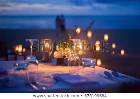 Romantic dinner setup on the beach  Stock photo © dashapetrenko