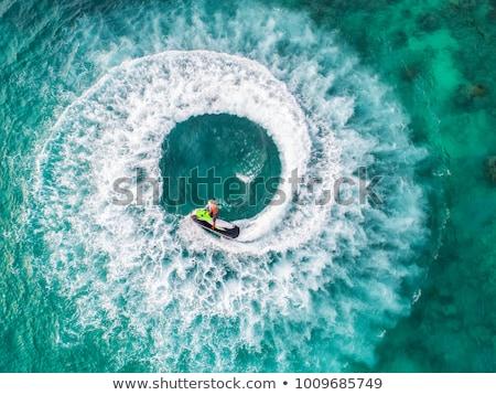 Jet ski férfi lovaglás víz nyár jókedv Stock fotó © bluering