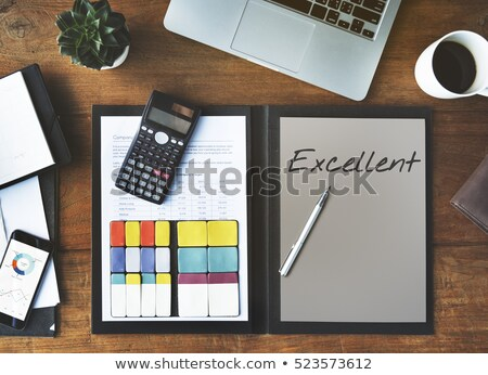 well done word and office tools on wooden table stock photo © fuzzbones0