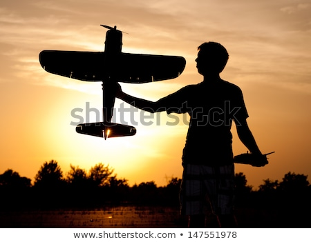 remote controlled airplanes at sunset Stock photo © adrenalina