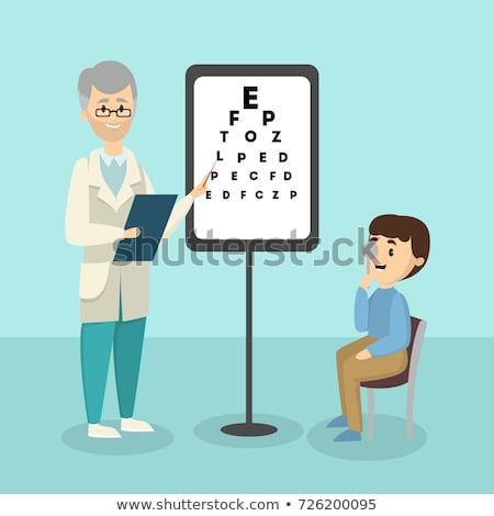 doctor ophthalmologist checking eyesight Stock photo © OleksandrO