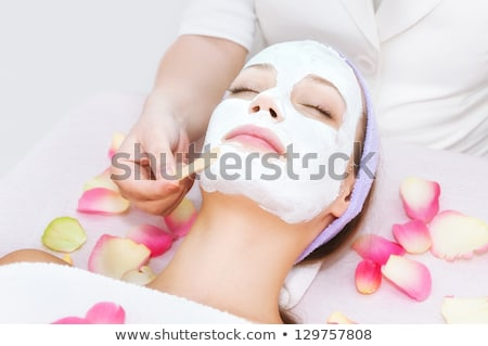 woman with facial mask and rose stock photo © phbcz