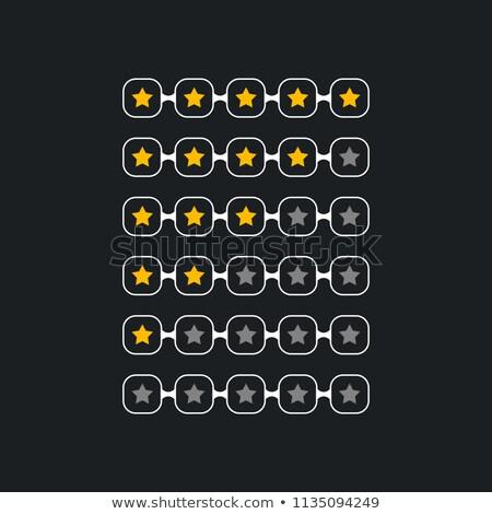star ranking rating symbols in dark theme Stock photo © SArts