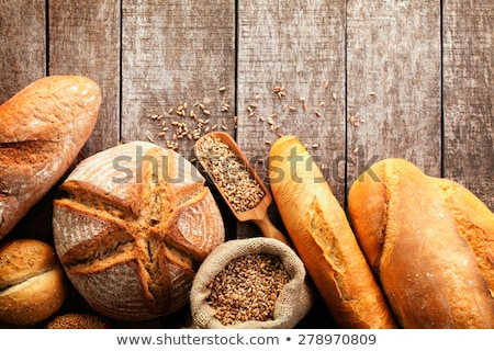 Assortment of fresh baked bread on wooden table background Stock photo © Yatsenko