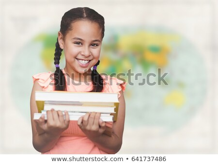 Stock photo: Girl with books against blurry map