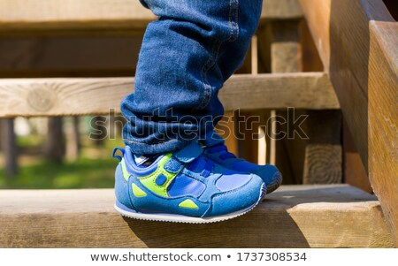 Girl wears with black sneakers walking on wood Stock photo © manaemedia