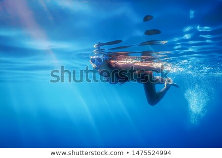 Stock photo: Woman diving or snorkelling in ocean