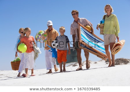 three young children in towel on beach stock photo © is2