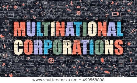 Multinational Corporations Concept. Multicolor on Dark Brickwall. Stock photo © tashatuvango