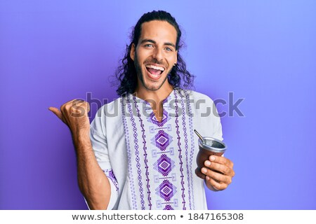 Hippie man with open mouth pointing finger up. Stock photo © RAStudio