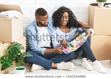 young family on floor with color samples stock photo © is2