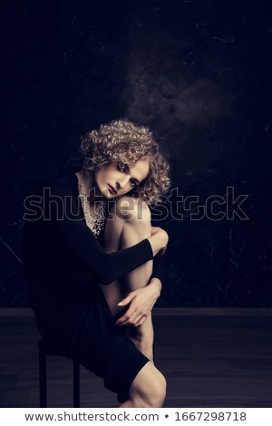 Androgynous man posing with hands on his head Stock photo © wavebreak_media