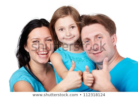 laughing girl in a T-shirt giving thumbs-up Stock photo © Lupen