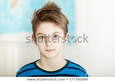 Young boy posing with a map Stock photo © acidgrey