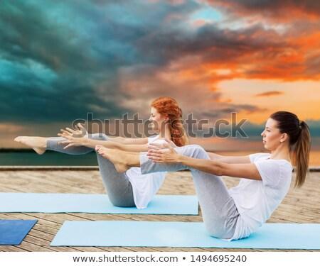 Donna yoga posa esterna fitness Foto d'archivio © dolgachov