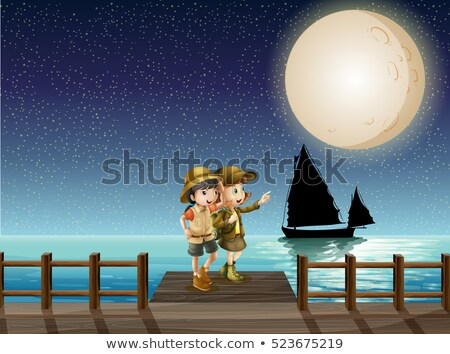 Two girls looking at fullmoon on the pier Stock photo © colematt