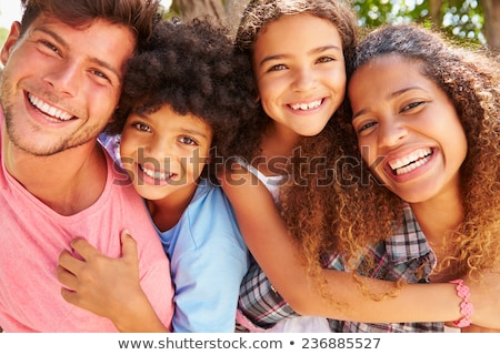 mixed race hispanic and caucasian son and father having fun at t stock photo © feverpitch