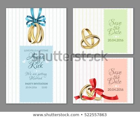 wedding rings on invitation with a red ribbon stock photo © ruslanshramko