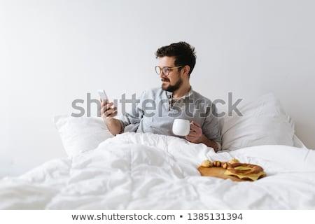красивый · молодым · человеком · завтрак · домой · рубашку - Сток-фото © boggy