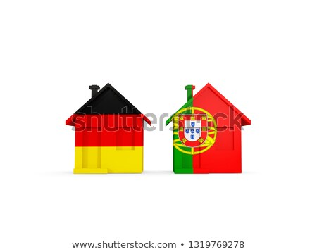 Two houses with flags of Germany and portugal Stock photo © MikhailMishchenko