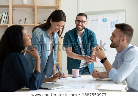 Team of people works together on company statistics. Concept of teamwork and partnership. Double exp Stock photo © alphaspirit
