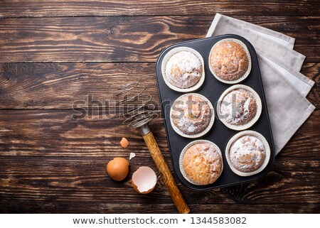 Sweet homemade cupcakes in backing dish Stock photo © furmanphoto