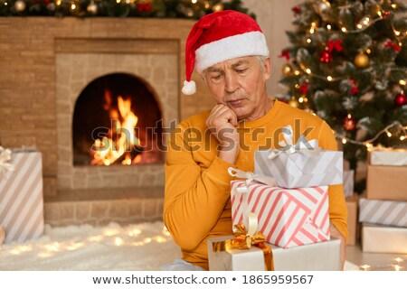 Jeden palec Święty mikołaj hat choinka wakacje Zdjęcia stock © dolgachov