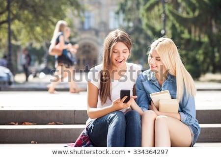 twee · gelukkig · jonge · vrouwen · vrouwen - stockfoto © deandrobot