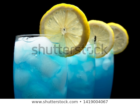 closeup view of blue lagoon cocktails with ice cubes on black stock photo © dla4