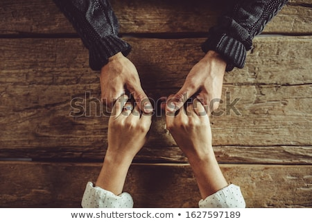 cropped image from above of caucasian man sitting at table in of stock photo © deandrobot