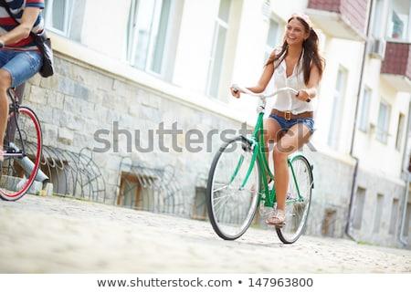 jonge · vrouw · paardrijden · fiets · buiten · kant · gelukkig - stockfoto © Lopolo