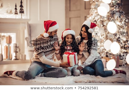 daughter and mother with christmas gift at home stock photo © dolgachov