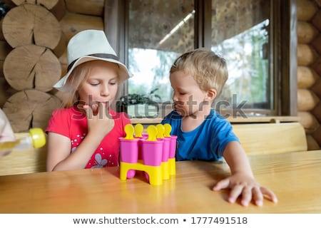 Cute мало мальчика еды домашний Сток-фото © galitskaya