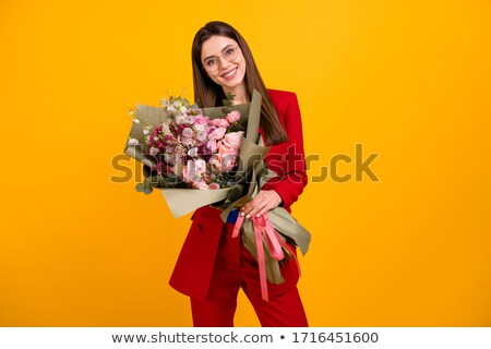 Stock photo: red haired girl with flowers at birthday party