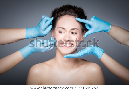 The doctor measuring patient's face before plastic surgery Stock photo © Elnur