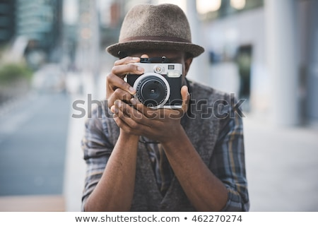 Jóképű férfi régi fényképezőgép fehér póló fekete nyakkendő Stock fotó © Giulio_Fornasar