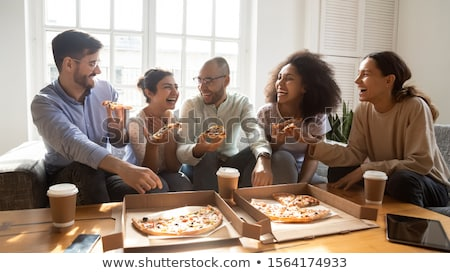 indian man with takeaway pizza box at home Stock photo © dolgachov