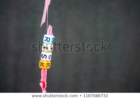 Risk, Colorful words hang on rope stock photo © Ansonstock